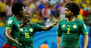 Cameroon's Achille Weboc  tries to separate teammates Benjamin Moukandjo and Benoit Assou-Ekotto after they clashed at  the Amazonia arena in Manaus. Photograph: Murad Sezer/Reuters
