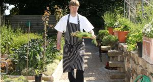 Graham Neville, head chef at Restaurant FortyOne, collecting produce from the kitchen garden in Killiney