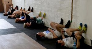 Walking the walls: members working out in the gym. Photograph: David Sleator