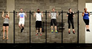 Zofia Siok with 'Irish Times' reporter Ciarán D'Arcy, Alan Doyle, head coach, Ken Fox, Ciara Herrity and Derval Cunningham work out in D12 Crossfit gym. Photograph: David Sleator