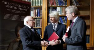 President Michael D Higgins with editors Barra Boydell, former professor in the Department of Music at NUI Maynooth, and Harry White, professor of music at UCD, at the launch of The Encyclopaedia of Music in Ireland in Dublin last October. Photograph: Peter Houlihan