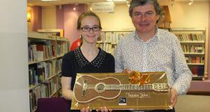 Young writer Fiona Buckley and singer-songwriter John Spillane at the luanch of her first book, Better Than Gold
