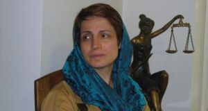 Human rights lawyer Nasrin Sotoudeh was held for three years in Evin prison and released after Iranian president Hassan Rouhani's election. She keeps a statue of the goddess of justice in her Tehran office. Photograph: Lara Marlowe