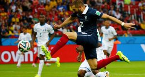 France's Karim Benzema scores against Honduras during the opening game in Group E.