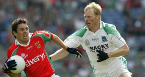 Liam McBarron of Fermanagh (right) in action against Mayo's Fergal Kelly in the All-Ireland SFC semi-final replay in August 2004. Photograph: Billy Stickland/Inpho