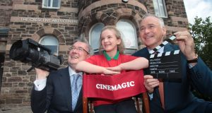 Chief executive of the Worldwide Ireland Funds, Kieran McLoughlin (l), Angel Regan (11) from North Belfast and Chairman of the American Ireland Fund, John Fitzpatrick on a visit to Cinemagic, a project in receipt of financial support from the Ireland Funds. Photograph: Aengus McMahon