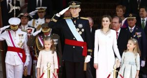 King Felipe VI of Spain and Queen Letizia of Spain with daughters Princess Leonor and Princess Sofia  leave the Congress of Deputies during the King's official coronation ceremony in Madrid yesterday. Photograph: Andreas Rentz/Getty Images