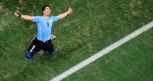 Uruguay's Luis Suarez celebrates scoring his  second goal against England   at the Corinthians Arena in Sao Paulo. Photograph: Francois Xavier Marit /  Reuters