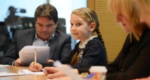 Abigail Irwin (9) from Navan at The Irish Times news conference with reporter Ronan McGreevy. Photograph: Cyril Byrne/The Irish Times