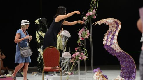 Harumi Langford working on a display called Ebb and Flow at the World Flower Show at the RDS. Photograph: Cyril Byrne/The Irish Times