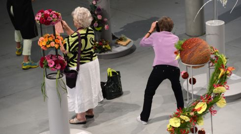 A visitor takes photographs of entries at the World Flower Show. Photograph: Cyril Byrne/The Irish Times