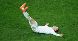 Wayne Rooney of England falls on the ground during the 2014 FIFA World Cup Brazil Group D match between Uruguay and England at Arena de Sao Paulo on June 19, 2014 in Sao Paulo, Brazil. (Photo by Matthias Hangst/Getty Images)