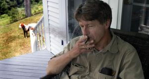 No smoke without ire: PJ O'Rourke at his farmhouse in New Hampshire in 2004. Photograph: Michele McDonald/Boston Globe