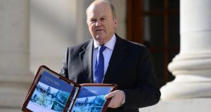 A file image of Minister for Finance Michael Noonan with Budget 2014. The Minister has said an adjustment of less than €2 billion may be required in the budget this year, placing him at odds with the IMF, the EC and the Irish Fiscal Advisory Committee.