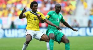 Yaya Toure shields the ball from Colombia's Carlos Sanchez during the Ivory Coast's 2-1 World Cup Group C defeat, just hours before learning of the death of his brother, Ibrahim.