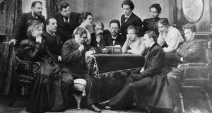 Anton Chekhov reads his play, The Seagull, to actors. Chekhov's desk faced the wall, soaked in sunlight. From here he embraced both of his callings: medical and artistic, Photograph: Sovfoto/UIG via Getty Images