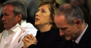 Praying for change: Mary McAleese at Mass with her husband, Martin, in 2008. Photograph: Eric Luke