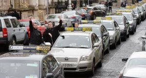 The ESRI said the current cap on new taxi licences was not justified and would lead to the lengthening queues and longer waiting times for consumers. Photograph: Alan Betson