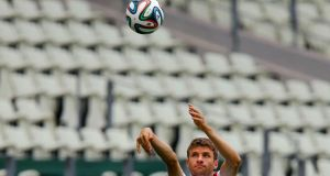 Thomas Müller works on his basketball skills before the Germany squad started  practice at Castelo Stadium in Fortaleza ahead of their World Cup Group G match against Ghana. Photograph: Mike Blake/Reuters