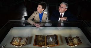 Susie Bioletti of TCD and Peter Keegan of Bank of America Merrill Lynch view 'The Book of Dimma' the 'Garland of Howth' and the 'Book of Mulling'. Photograph: Cyril Byrne