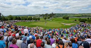 Crowds gather around the 7th green at Fota Island yesterday to watch Padraig Harrington, Rory McIlroy and Stephen Gallacher  during the second round of the Irish Open yesterday. Photograph:  Ross Kinnaird/Getty Images.