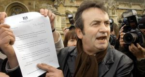 Gerry Conlon faces the media showing them the letter of apology he received from British prime minister Tony Blair outside the House of Commons in  London on  February 9th, 2005. File photograph: Stefan Rousseau/PA