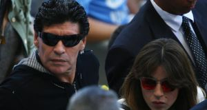 Diego Maradona  and his daughter Giannina  look on during the  World Cup  Group F match against Iran at Estadio Mineirao  in Belo Horizonte. Photograph: Ian Walton/Getty Images