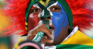 A South Africa fan in Pretoria, 2010:  about €2.5bn was spent on new stadiums, renovating airports, upgrading roads and a high-speed public railway. Photograph:  Cameron Spencer/Getty Images