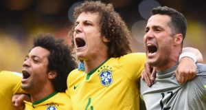 There's no lack of passion from Brazil's Marcelo, David Luiz and Julio Cesar as they sing their national anthem before the game against Mexico.