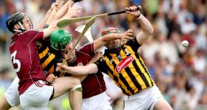 Galway's Ronan Burke and Fergal Moore tussle with Mark Kelly and Eoin Larkin of Kilkenny. Photograph: Inpho