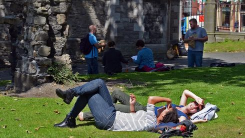 Lazing on a sunny afternoon this week at Christ Church Cathedral. Photograph:  Eric Luke/The Irish Times