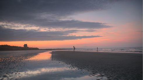 Enjoying the last rays of the sun at 10.45pm on Portmarnock Beach, Co Dublin, on June 18th, 2014. Photograph: Ashley Lowrey