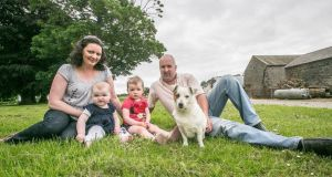Brian and Norma Rohan with their children, Emily (11 months) and Julie (2),  on the family farm in Shanahoe, Co Laois. Brian's father, Liam, died in a farm accident. Photograph: Pat Moore.