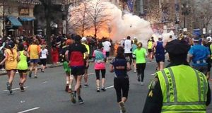 """The dreadful mistakes made by both social and established media in the immediate aftermath of the Boston Marathon bombing - when more than one entirely innocent young man was fingered as likely suspects - should stand as a warning that technology platforms are neutral pieces of machinery. It's how they're used that makes the difference.""  Above, an explosion erupts near the finish line of the Boston Marathon. Photograph: Dan Lampariello/Reuters"