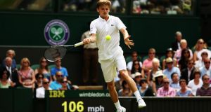 Belgium's David Goffin returns to Andy Murray during their first-round match at Wimbledon. Photograph:  Matthew Stockman/Getty Images