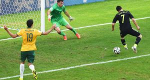 David Villa flicks the ball past Australian goalkeeper Mathew Ryan. Photograph: David Ramos/Getty Images