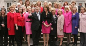 TDs and Senators with Taoiseach Enda Kenny on the plinth at Leinster House to celebrate International Women's Day 2012. A new report says there are far too few women in politics. Photograph: Alan Betson/The Irish Times