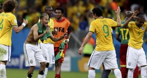 Neymar (shirtless) of Brazil and Fred celebnrate after the FIFA World Cup 2014 group A preliminary round match between Cameroon and Brazil. Photograph: Marcelo Sayao/EPA
