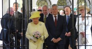 Queen Elizabeth visits with Northern Ireland First Minister Peter Robinson (right) and Deputy First Minister Martin McGuinness (centre) the Crumlin Road jail  in Belfast today. Photograph: Getty
