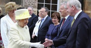 Britain's Queen Elizabeth shakes hands with Northern Ireland's deputy First Minister Martin McGuinness (right) as she arrives for a visit of Crumlin Road jail in Belfast today. Photograph: Reuters