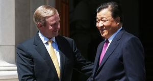 Taoiseach, Enda Kenny, greets Mr Liu Yunshan, at Government Buildings, Dublin.  Photograph: Brian Lawless/PA