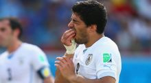 Uruguay go through but Luis Suarez in the dock again