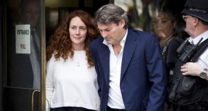 Rebekah and Charlie Brooks leave the Old Bailey in London yesterday after being cleared of all charges. Photograph: John Phillips/Getty Images