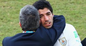 Head coach Oscar Tabarez of Uruguay hugs Luis Suarez after their  1-0 victory over Italy  at Estadio das Dunas  in Natal, Brazil. Photograph:  Julian Finney/Getty Images