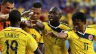 Juan Cuadrado (right) of Colombia celebrates with his teammates after scoring a penalty   at the Arena Pantanal in Cuiaba. Photograph: EPA