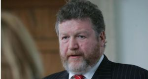 Minister for Health James Reilly accused Fianna Fáil of throwing money at the health service when in power instead of reforming it.