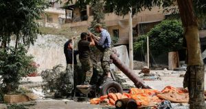 Members of Islamist rebel group Jabhat  al-Nusra prepare a home-made mortar in the Bustan al-Qasr neighbourhood of Aleppo. Photograph: Reuters/Hamid Khatib
