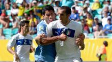 Uruguay once again rallies behind flawed native son Luis Suarez