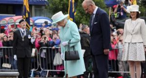 Queen Elizabeth and the Duke of Edinburgh at the Cenotaph in Coleraine.