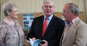 Tánaiste Eamon Gilmore, Henry Murdoch and his wife Davida at the launch of his new books. Photograph: Fergal Phillips
